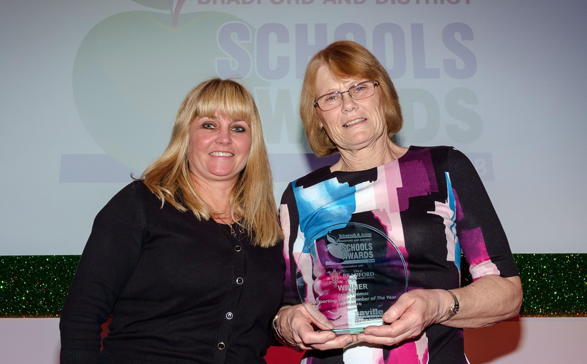 Anne Seddon of Saville AV with winner of the Supporting Staff Member Award, Janet Thomas of Canterbury Nursery School, at the 2018 T&A Bradford & District Schools Awards.