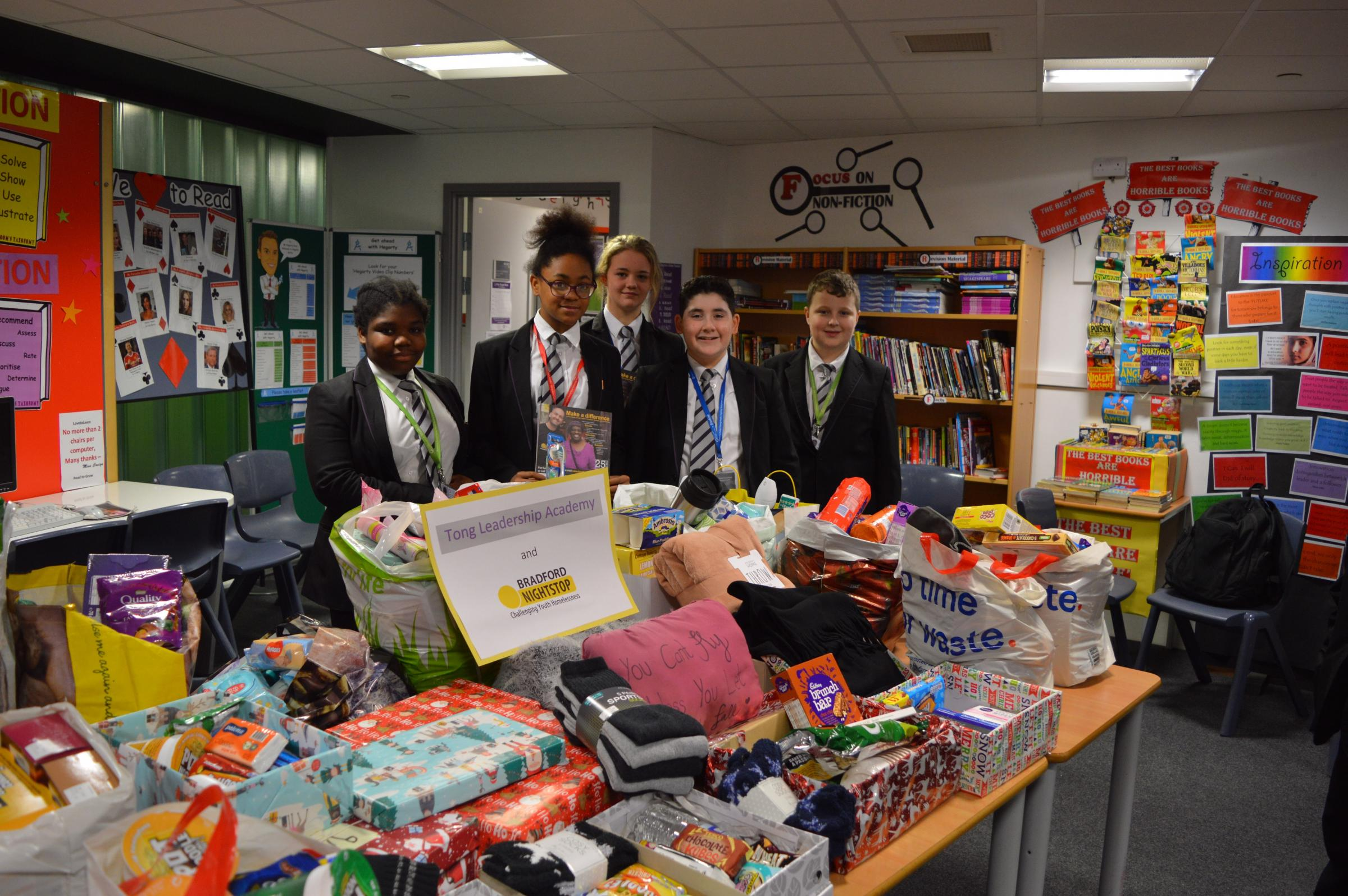 Students from Tong Leadership Academy with the donations for Bradford Nightstop