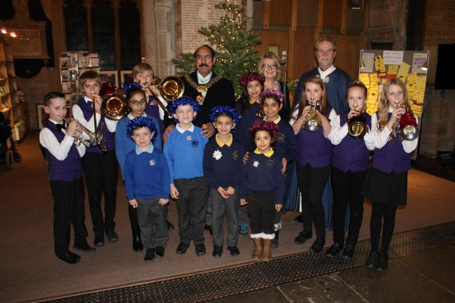 Back row (from left): Noah Mallinson and Louis Lancaster (Bradford Youth Brass Band), Saffa Imaan (Swain House Primary School), Alfie Sanderson (Bradford Youth Brass Band), the Lord Mayor of Bradford, Coun Zafar Ali, Maria Kinacova (Girlington Primary Sch