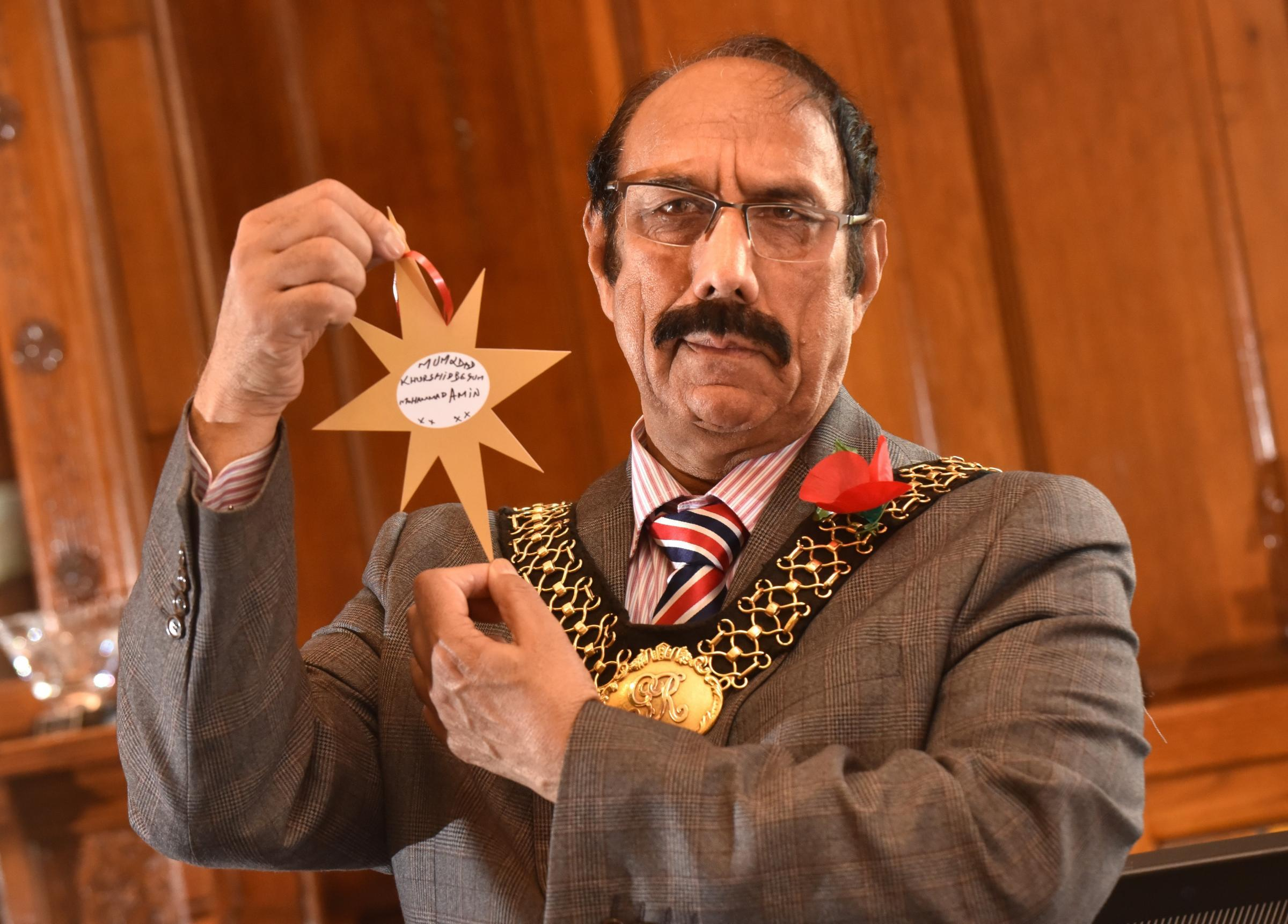 Lord Mayor of Bradford Cllr Zafar Ali with the Christmas star he dedicated to his parents