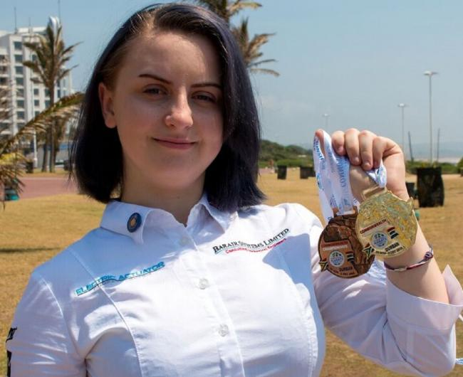 Katelyn Entwistle with her gold and bronze medals won at the Commonwealth Karate Championships in Durban, South Africa