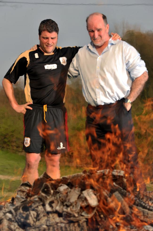 Billy Bingham, left, and Colin Nesbitt prepare themselves for their firewalk which will raise money to help young cancer sufferers