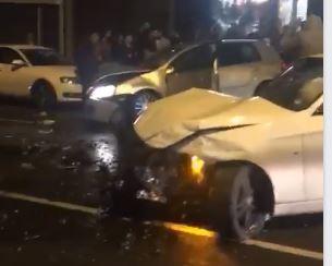 watch debris strewn across road in aftermath of three car crash on