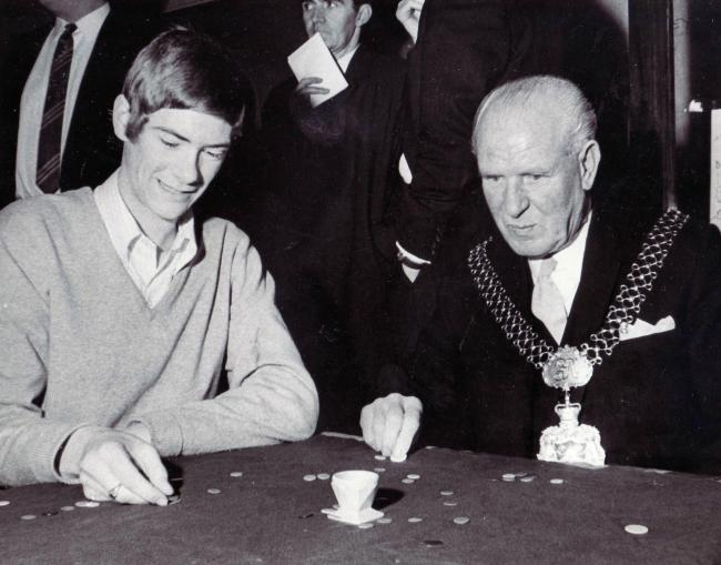 Lord Mayor of Bradford Alderman Arthur Walton lends a hand at the world tiddlywinks record bid in October 1968
