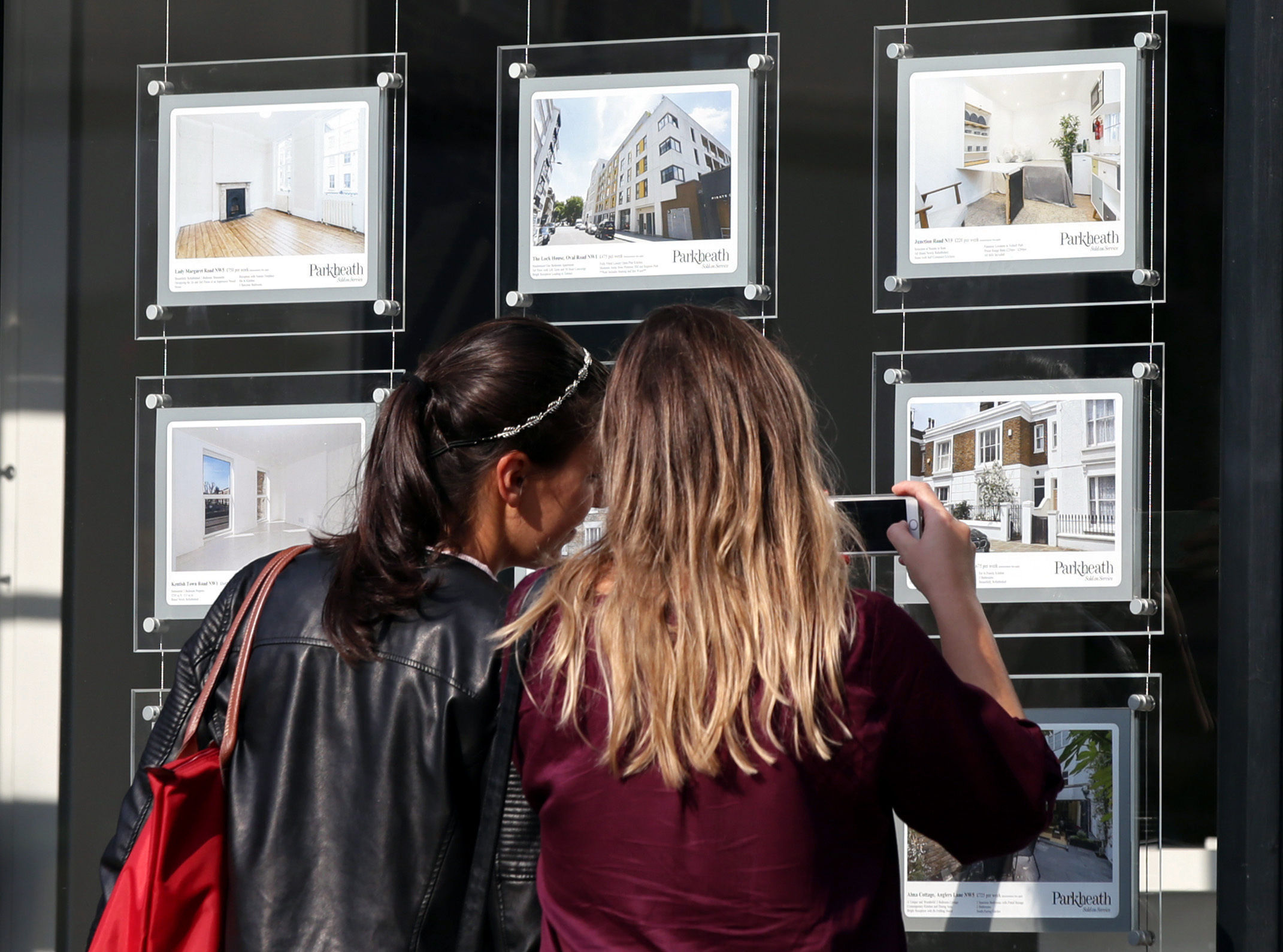 Two women studying houses for sale in an estate agent's window. Picture: Yui Mok/PA Wire