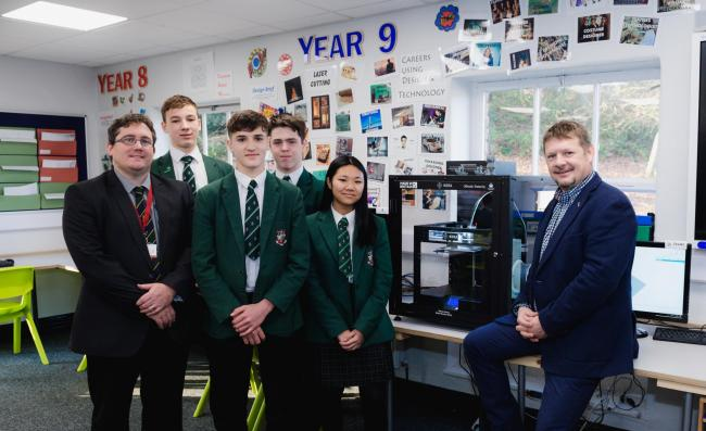 James Allison, head of DT, and students at Woodhouse Grove with the new 3D printer donated by Alex McIntosh, right, and his manufacturing firm Kora