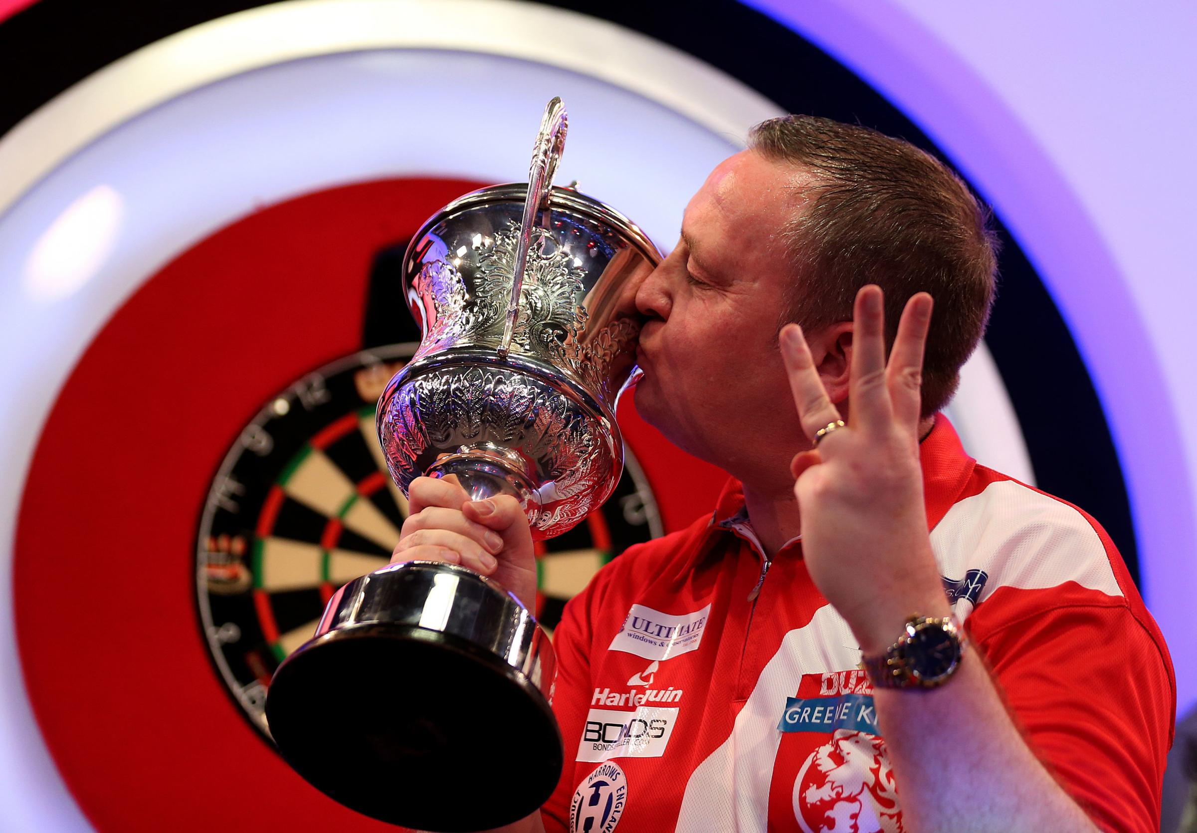 Glen Durrant celebrates winning with the trophy after 3 titles in a row during day nine of the BDO World Professional Darts Championship 2019 at The Lakeside, London. PRESS ASSOCIATION Photo. Picture date: Sunday January 13, 2019. See PA story DARTS Londo