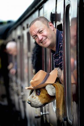 Dave Houghton who travels all over the UK by rail with his pal Herman the toy dog