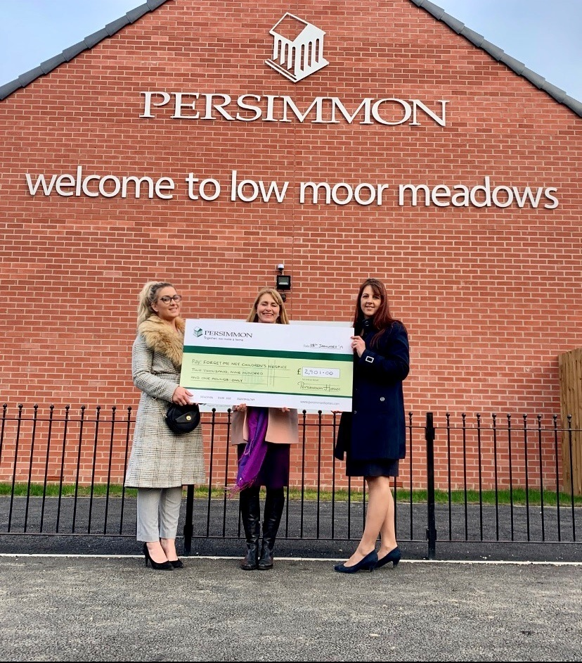 Hayley Mitchell, sales manager and Lisa Jones, sales advisor from Persimmon Homes presenting the cheque to Alison Parker from Forget Me Not Children's Hospice Picture: 8848 Communications