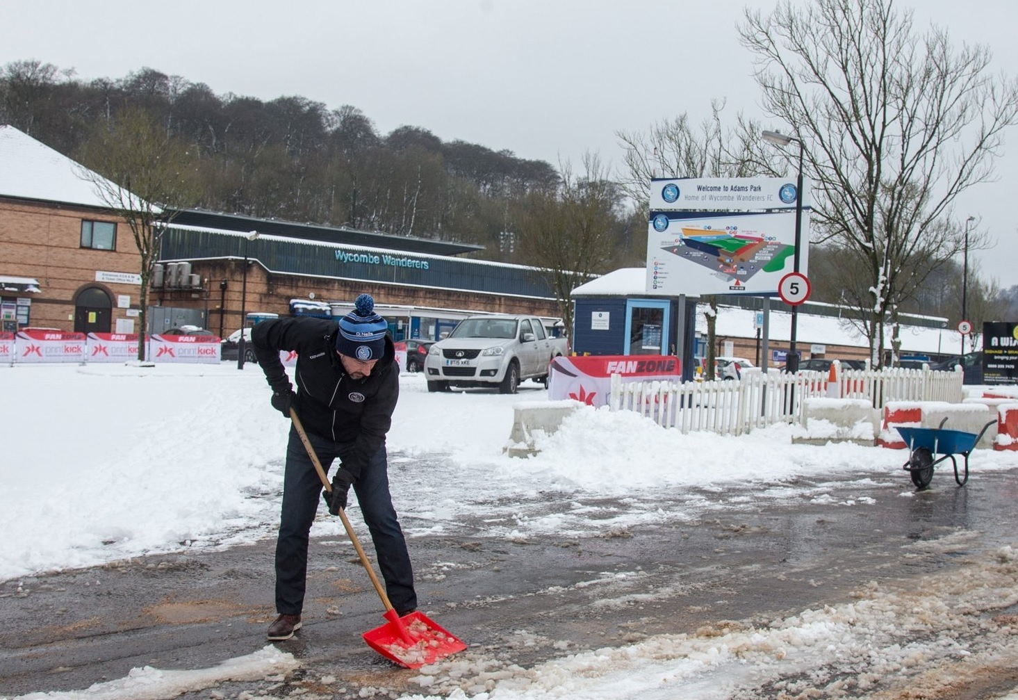 Wycombe Wanderers' general manager Michael Davies helps clear snow from around Adams Park today ahead of Bradford City's visit tomorrow. Picture: Wycombe Wanderers Twitter