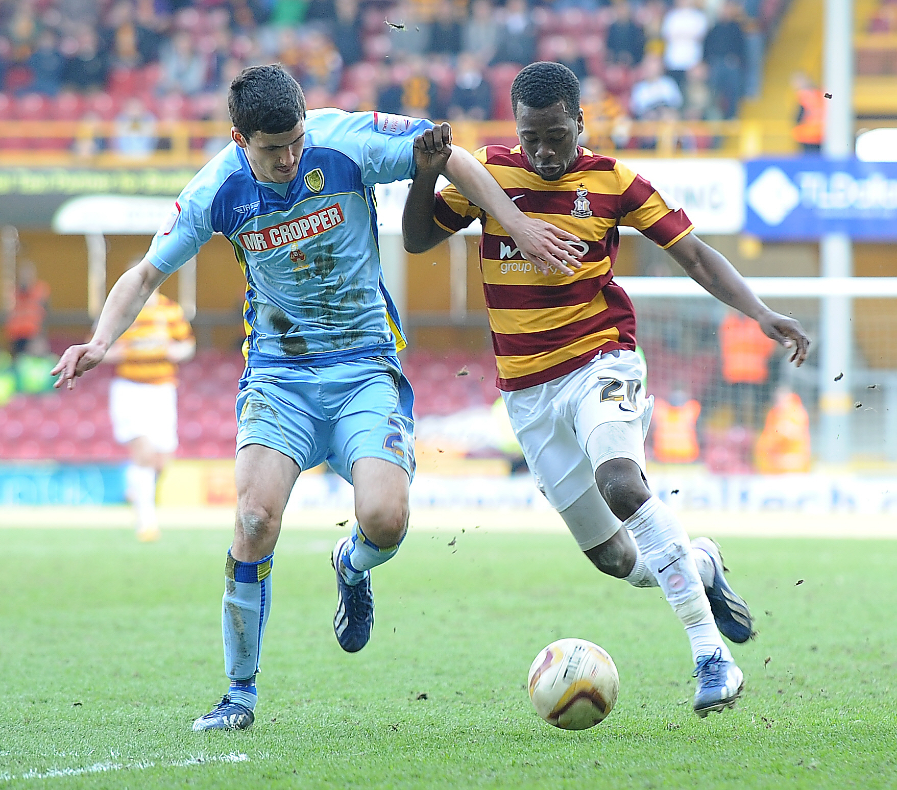 Zavon Hines, pictured right against Anthony O'Connor in the 2013 play-off semi-final against Burton at Valley Parade, has announced his retirement