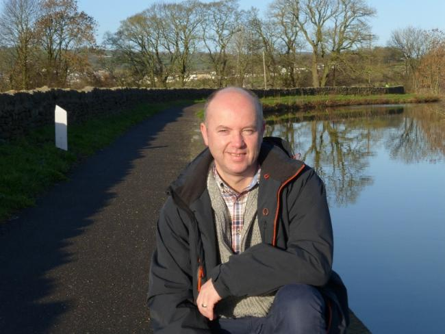 Silsden town councillor David Loud on part of the canal towpath that has been surfaced