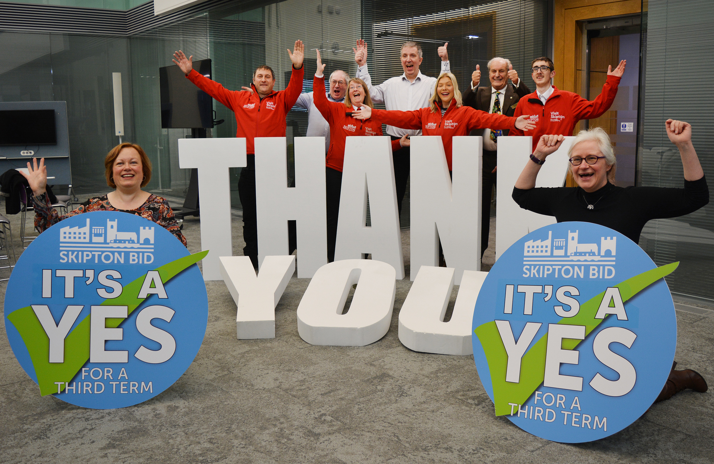 Officials celebrate the Yes vote