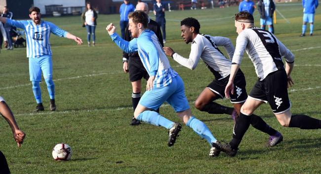 Lewis Morgan (blue and white stripes) netted twice for Crossflatts Village in their 8-1 win at Northern Picture: Richard Leach