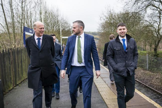 Chris Grayling, left, during a visit he made to Colne railway station