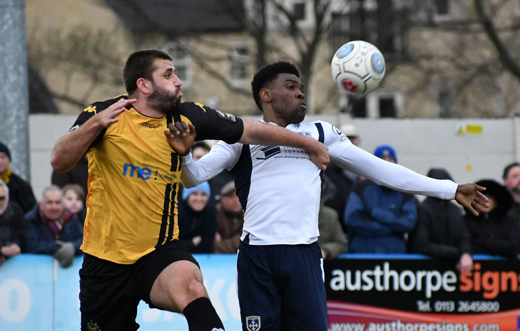 Guiseley's Kayode Odejayi, right, battles for the ball with Southport's Ryan Astles in the Lions' last Vanarama National League North clash earlier this month. Picture: Richard Leach