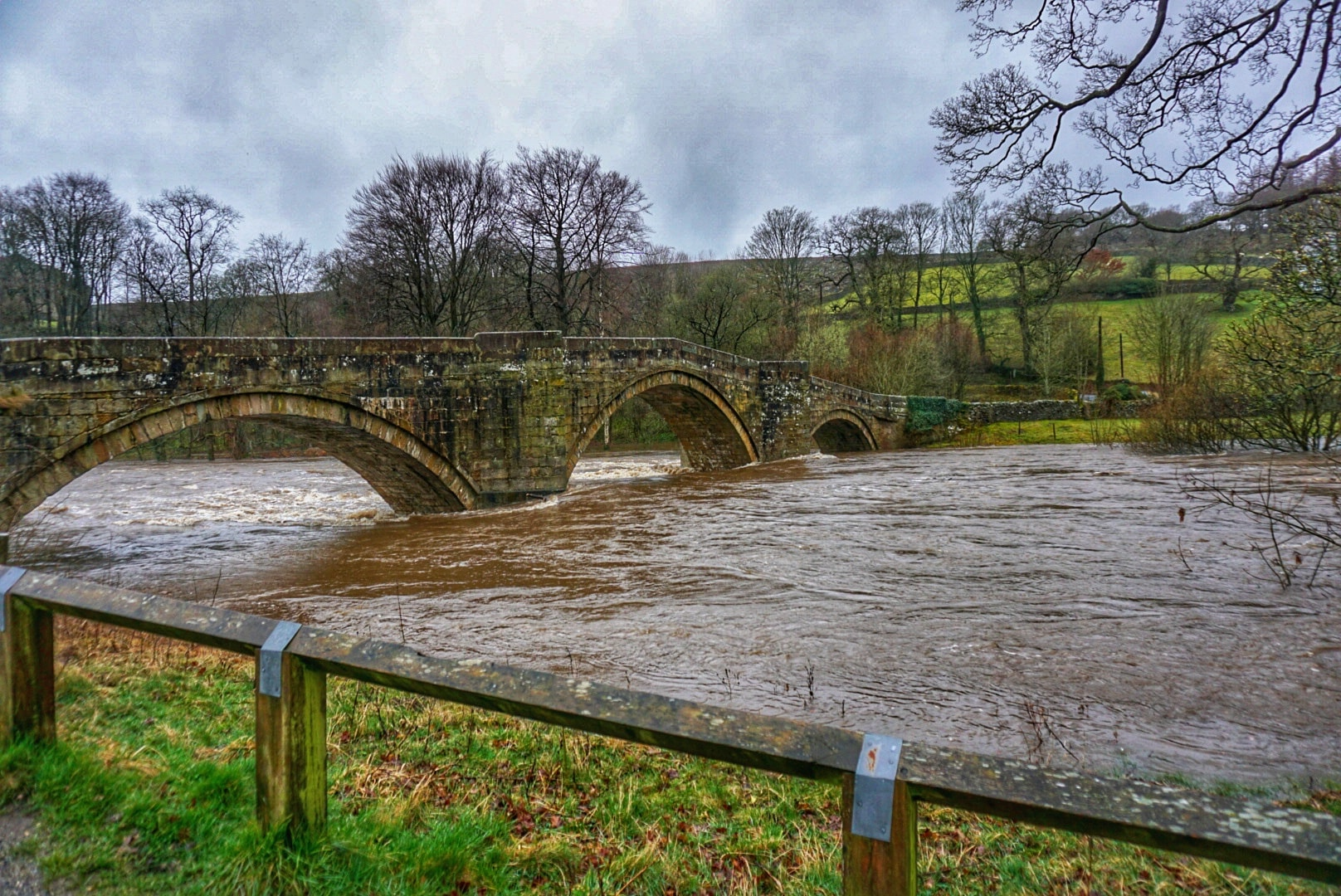What a difference a few months makes! Bridge battered by flood waters