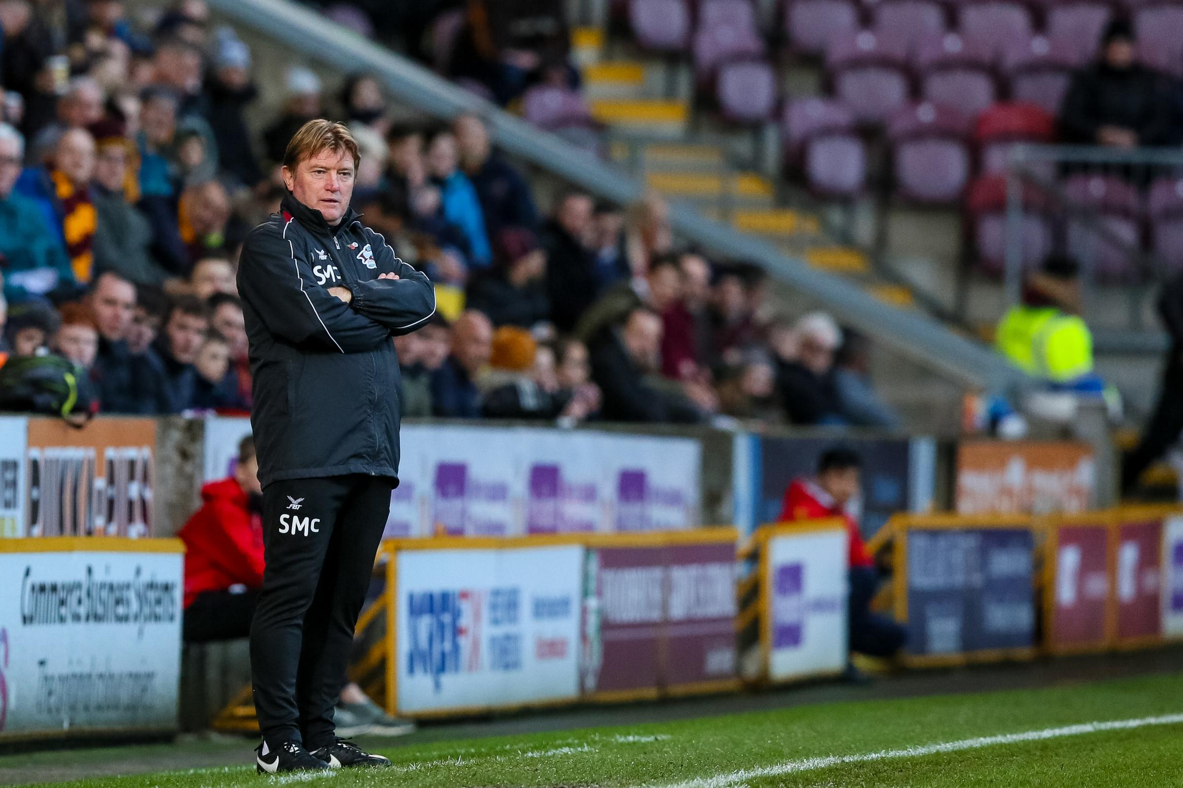 Stuart McCall, pictured on his return to City in December, has been sacked by Scunthorpe
