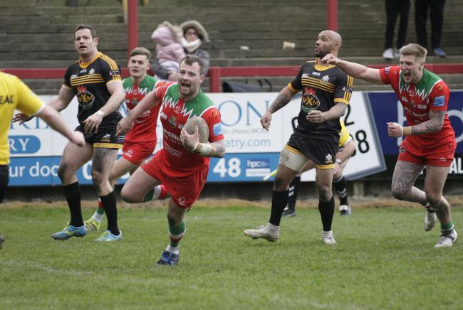 Josh Lynam runs in to score the match-winning try against North Wales Crusaders in March 2019. Picture: Charlie Perry.