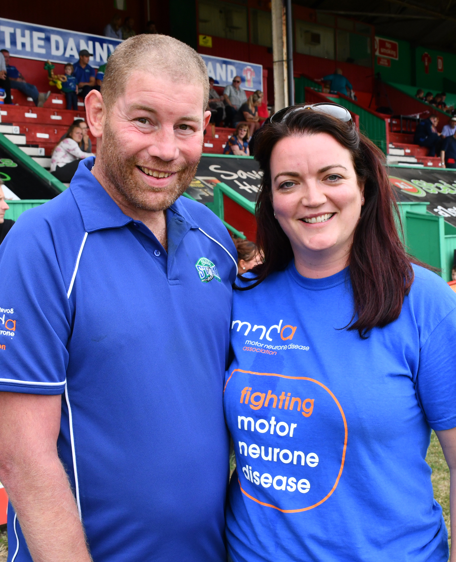 Two fans - one supporting Cougars and the other Bulls - are running from Odsal to Lawkholme Lane in support of former Keighley captain Phil Stephenson, left, who suffers from motor neurone disease