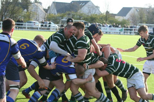 Joe Sowden, centre, scored two tries but it was a tough day for Old Grovians Pictures: Martin Green