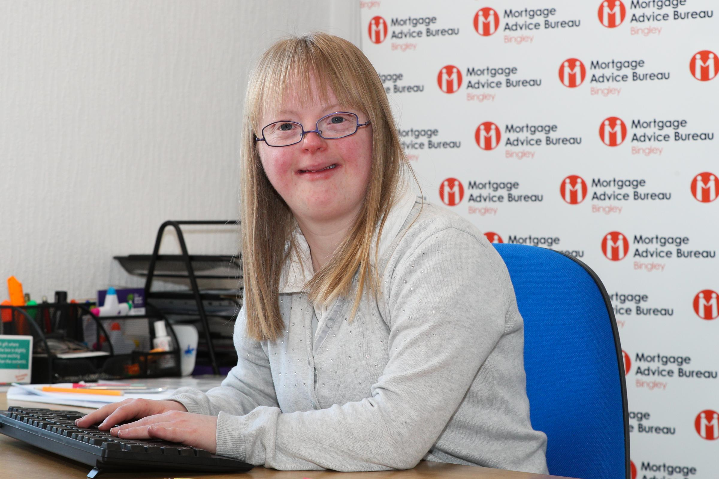 Rebecca Spalding at her desk during her work placement with Mortgage Advice Bureau in Bingley