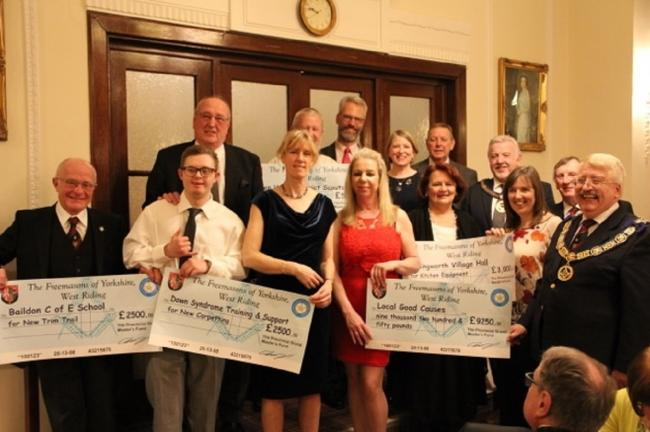 Freemasons of Yorkshire West Riding present a number of cheques to local causes