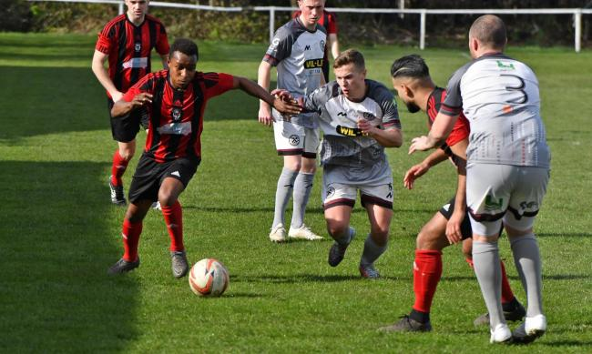 Campion (red and black) are racing towards the title and promotion with another win. Picture: Richard Leach.
