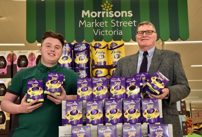 Apprentice Josh Weldon and Soup Run volunteer Michael Walsh sorting the eggs out at the Girlington store