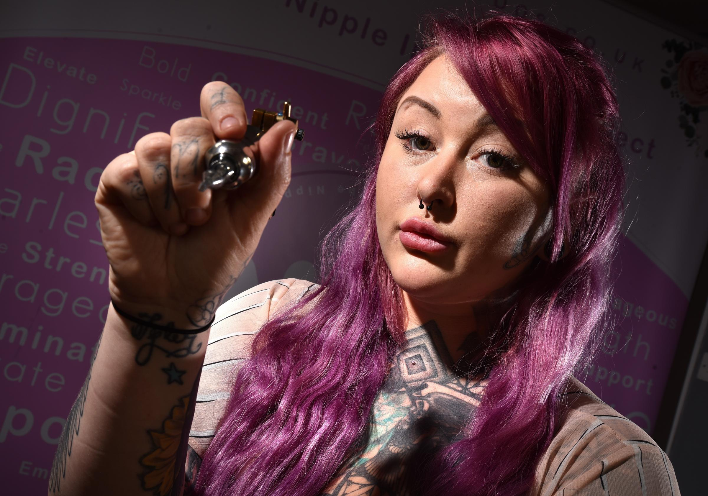 Mastectomy tatooist Lucy Thompson whose work helping breast cancer paitents with recovery has been banned by facebook.