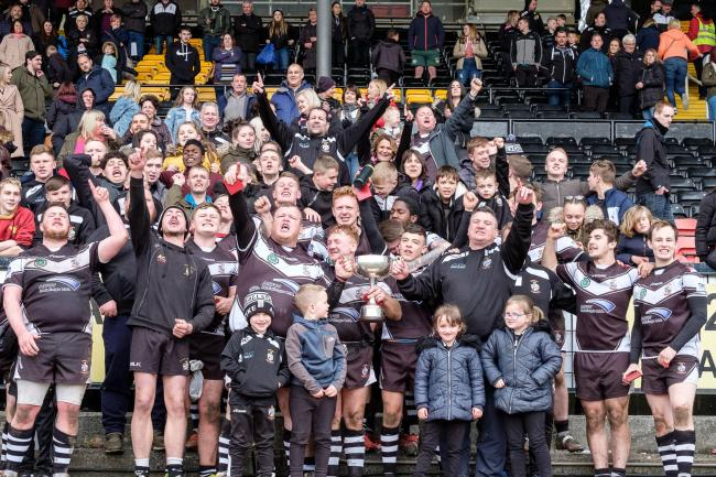 Victorious Wyke players and supporters celebrate their Jack Senior Memorial Cup win last season. They are now aiming to retain the trophy for the first time in more than 50 years