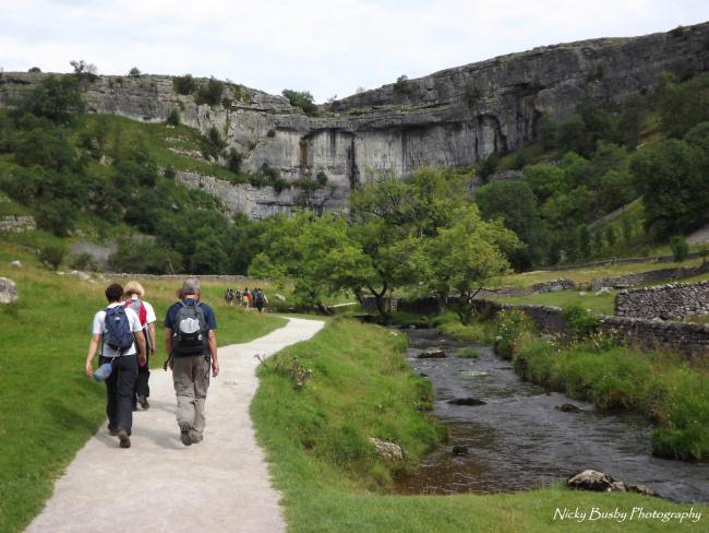 Walkers enjoy the sites of Malham Cove on a previous Walk For All event