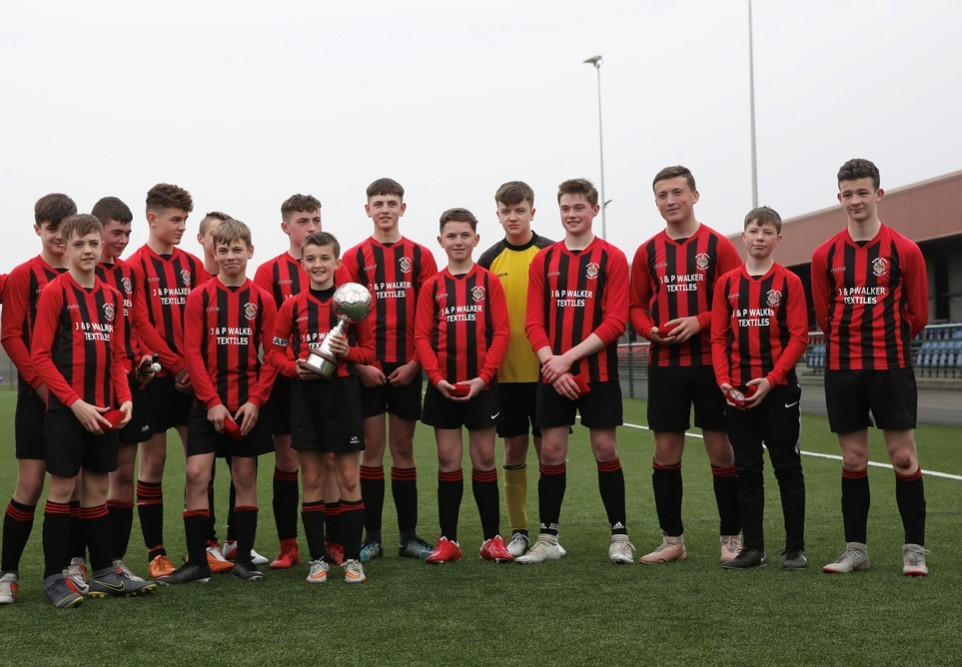 Bingley Juniors under-14s with their trophy