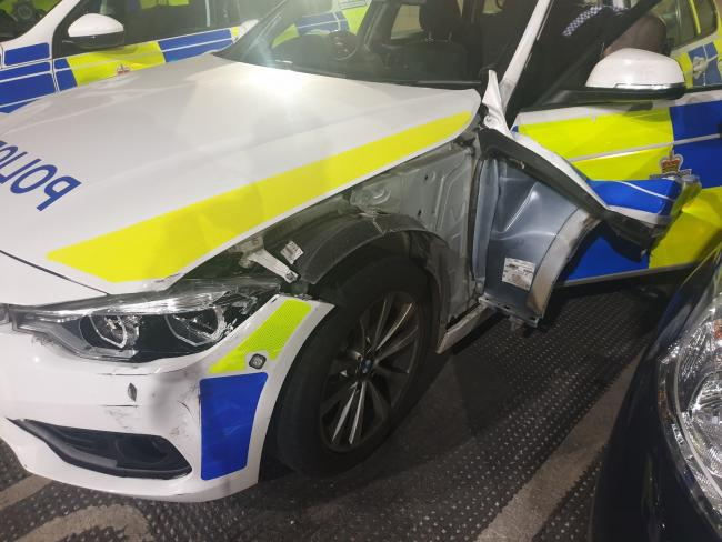 The damaged police car which was rammed in Bradford