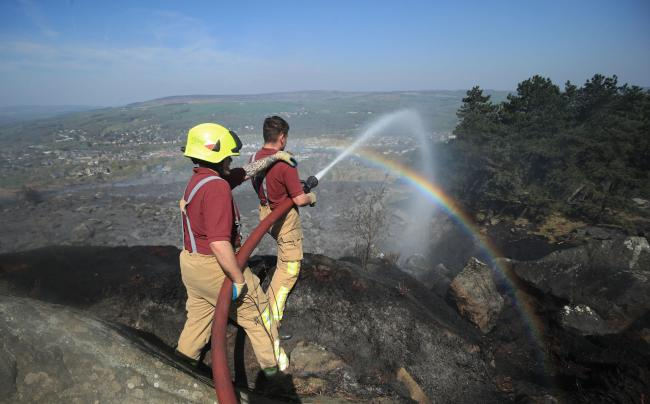 Firefighters tackling the Ilkley Moor fire. Photo: Danny Lawson/PA Wire