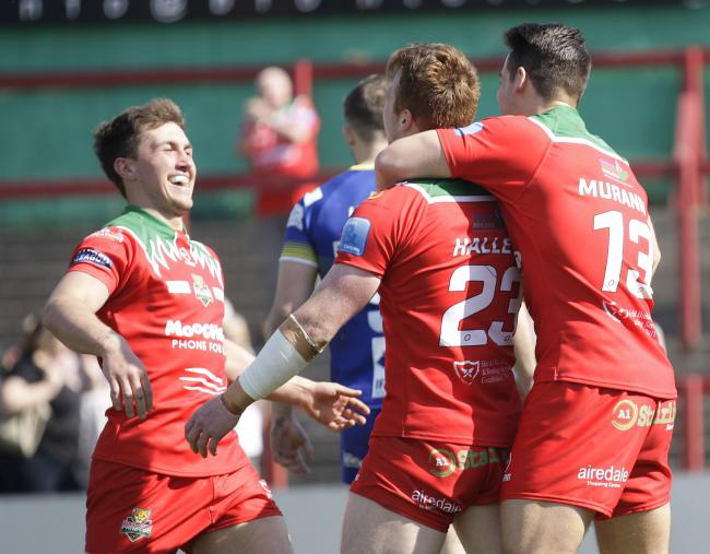 Macauley Hallett is congratulated by his team-mates for his try in Keighley Cougars' 28-16 win over Doncaster in Betfred League One. Picture: Charlie Perry