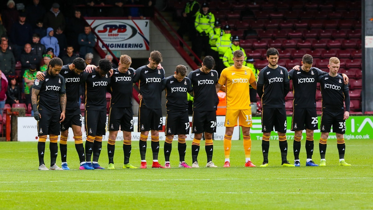 City observe a minute's silence before the Scunthorpe game. Picture: Thomas Gadd