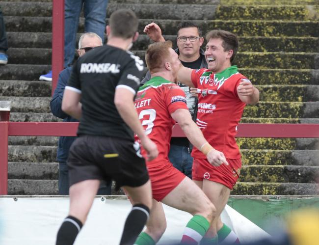Taylor Prell celebrates after scoring a try in Cougars' victory over Workington Town in Betfred League One. Picture: Charlie Perry