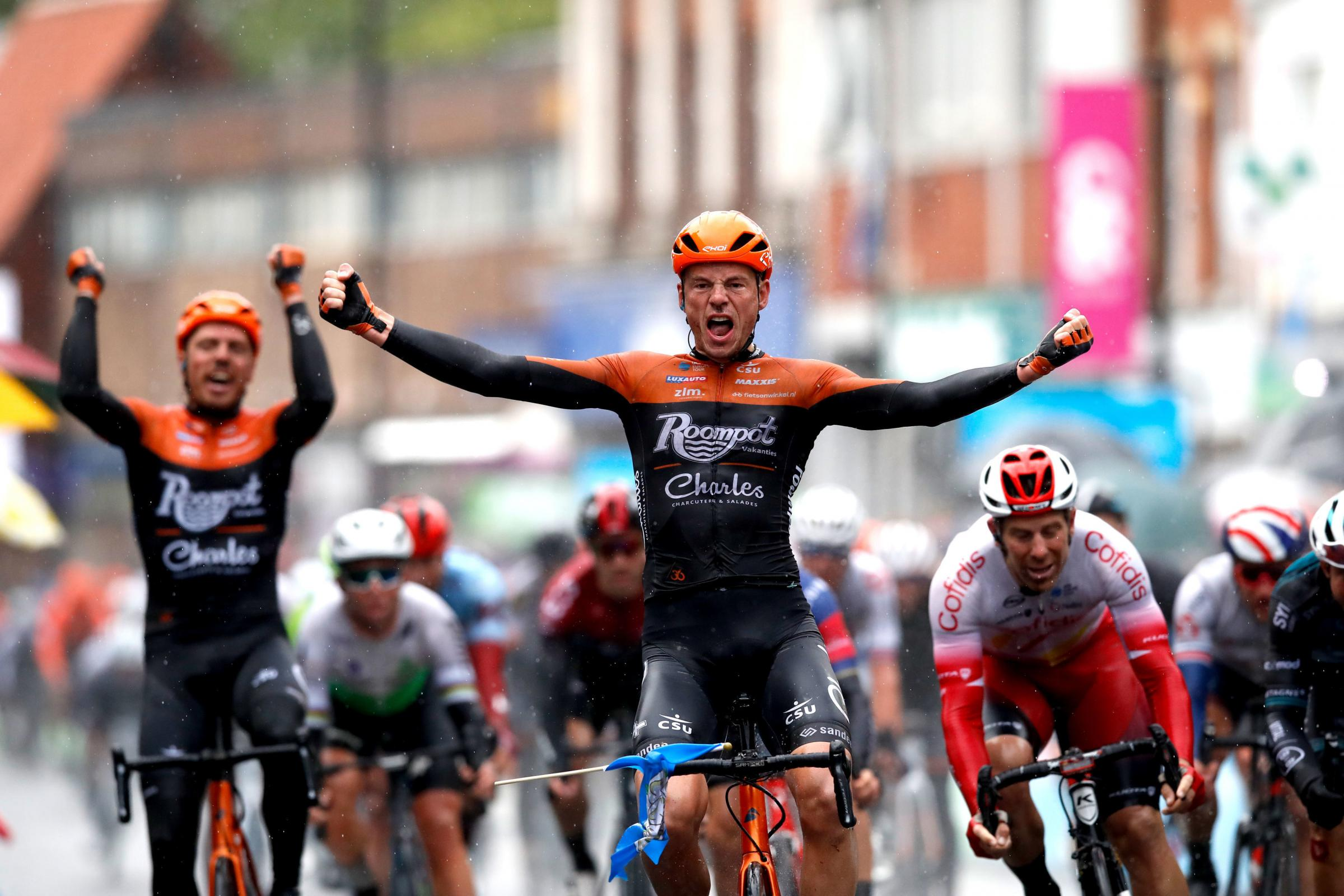 Team Roompot-Charles' Jesper Asselman (centre) celebrates winning stage one of the Tour de Yorkshire