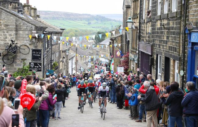 The break away group rides through Haworth during stage four of the Tour de Yorkshire. PRESS ASSOCIATION Photo.