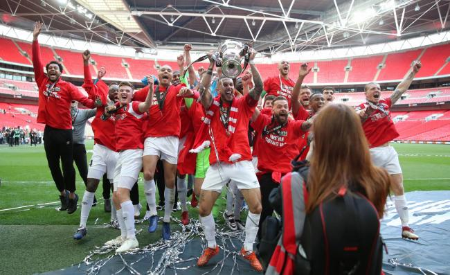 Salford City players celebrate with the trophy after winning the Vanarama National League Play-off Final  Picture: Bradley Collyer/PA Wire