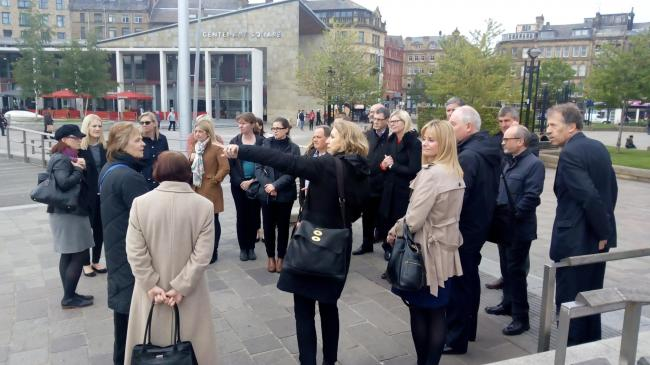 A group of Yorkshire business people during a tour of Bradford's regeneration projects; led by Shelagh O'Neill of the local authority