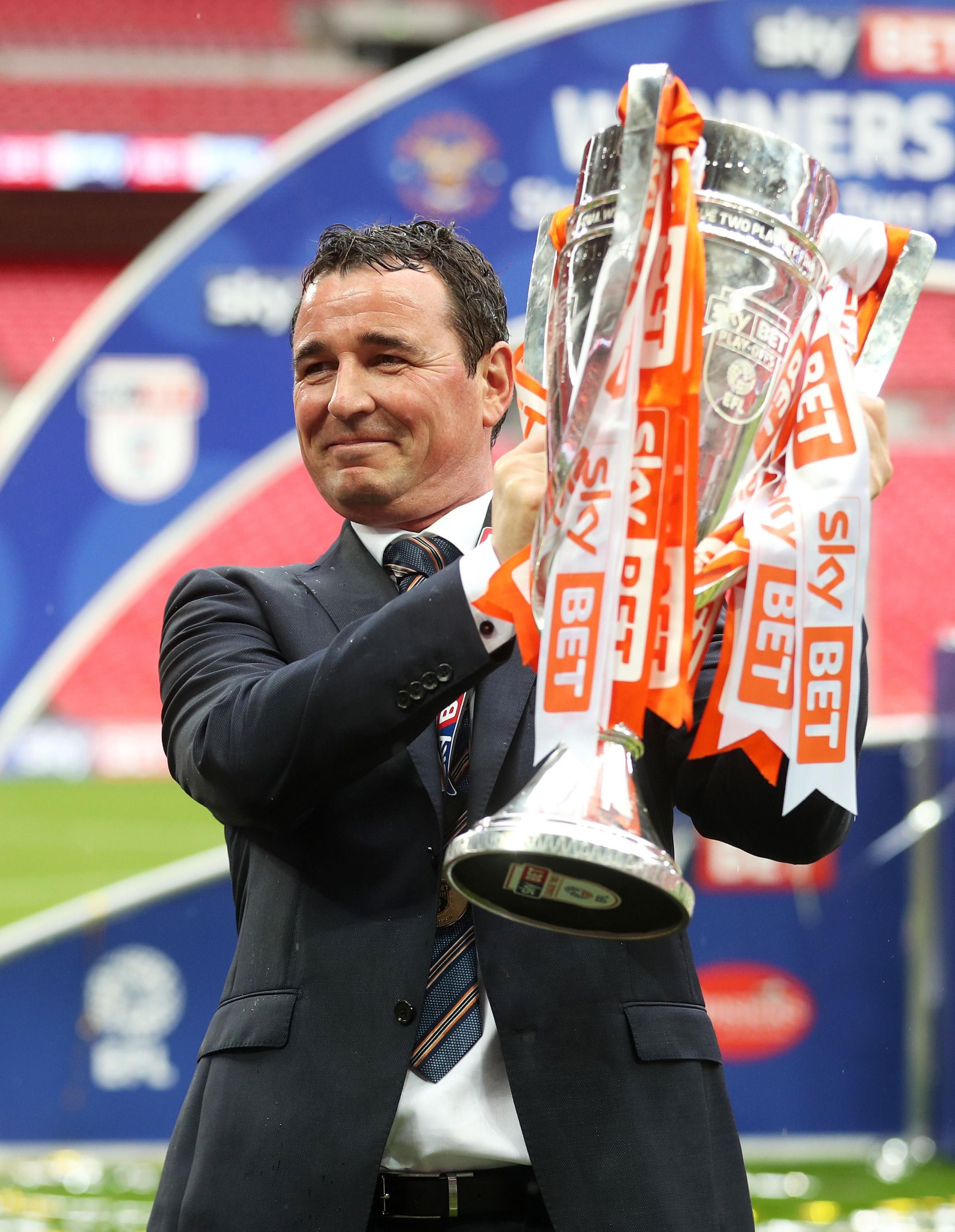 Gary Bowyer celebrates winning the League Two play-off final with Blackpool in 2017