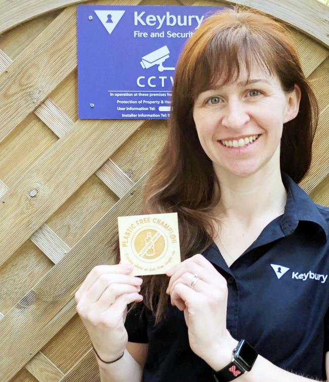 Keybury's Christine Bell with the 'plastic free business champion' badge