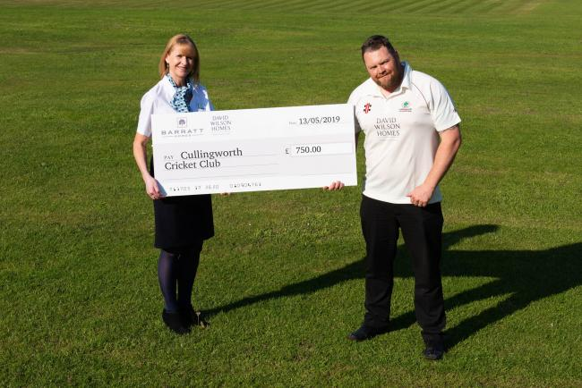 Karen Lencki presents a cheque to George Fletcher