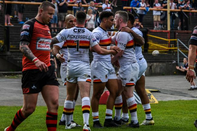 Bulls celebrate a try against Barrow in the league. The clubs will face off again in the 1895 Cup next month   Pic: Tom Pearson