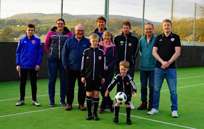 Organises of Ingleton MUGA fundraising campaign with three junior members. David McGonnigal, third from left