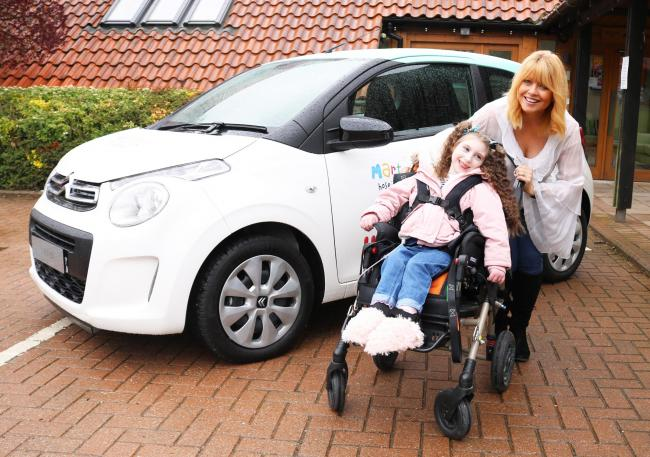 Martin House ambassador and ITV news presenter, Christine Talbot, launches the Martin House Grand Car Raffle with Lacie-Lea Rennie