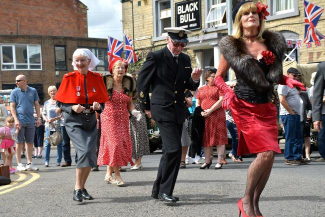 People dancing in the streets in the sunshine at last year's Brighouse 1940s weekend, as this year's plans are announced