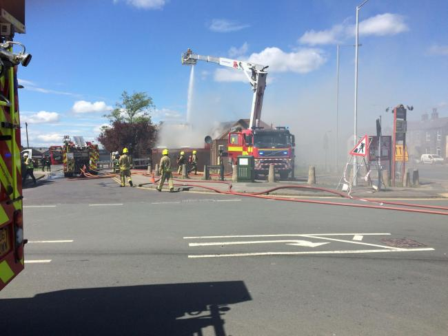 Firefighters tackling a fire at The Gallopers pub in Wakefield Road
